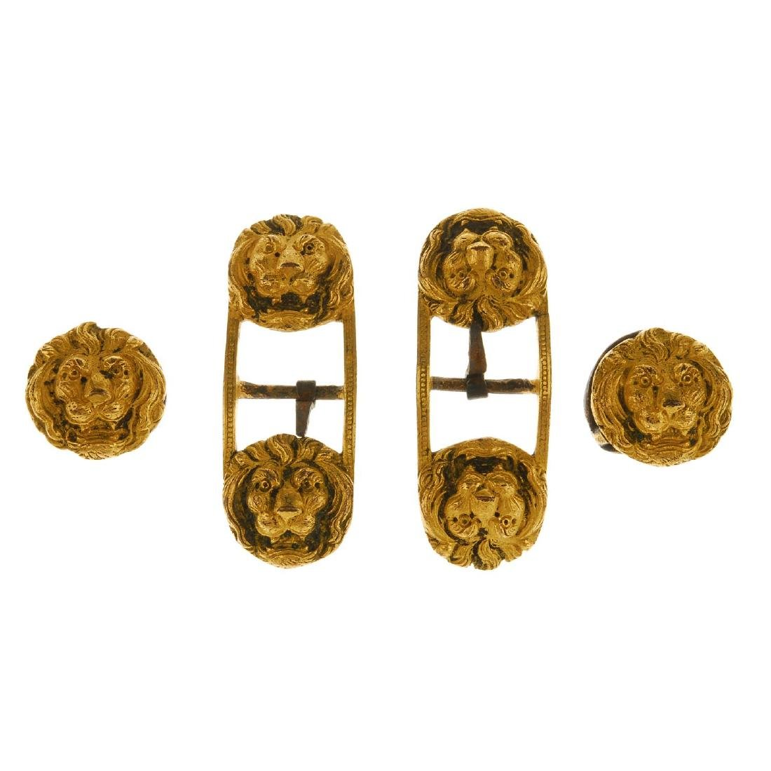 Four lion head buckles. The larger buckles designed as