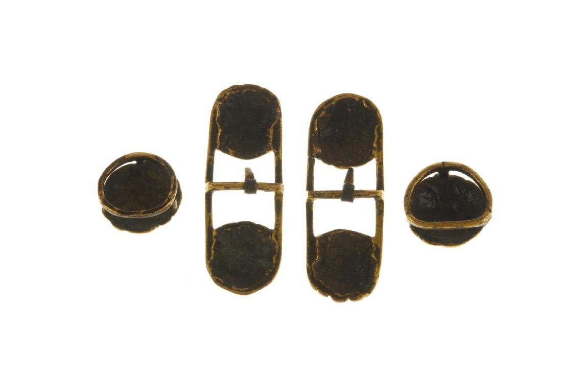 Four lion head buckles. The larger buckles designed as - 2