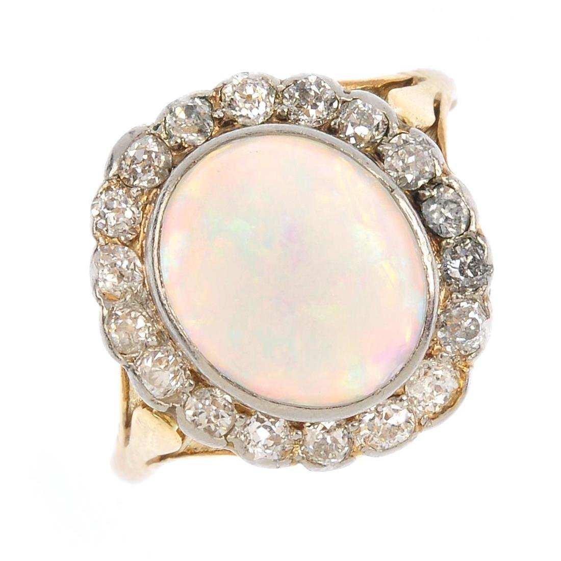 An early 20th century platinum and 18ct gold opal and