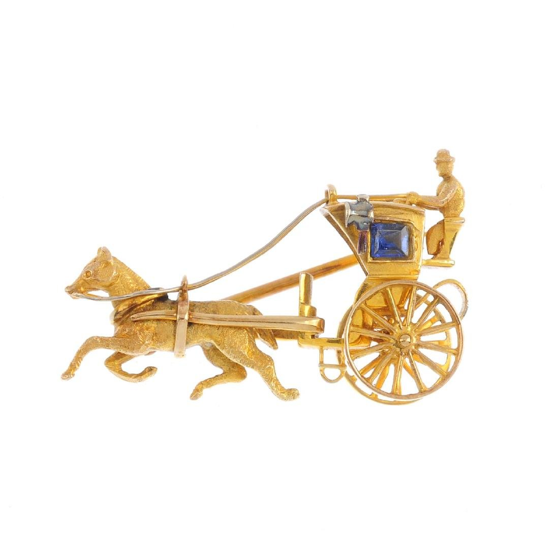 A 9ct gold and sapphire novelty brooch. Designed as a