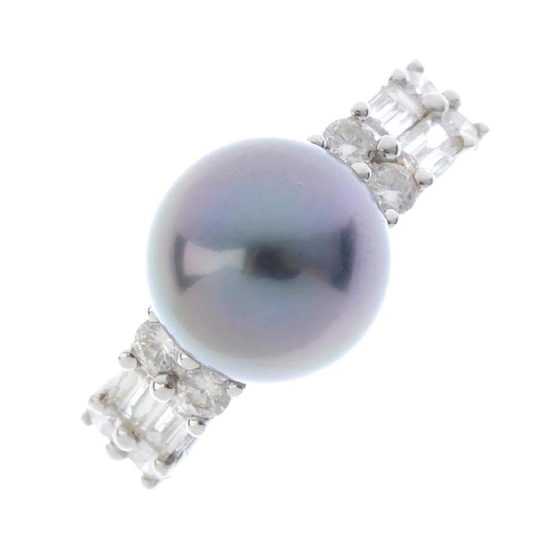 An 18ct gold cultured pearl and diamond ring. The grey