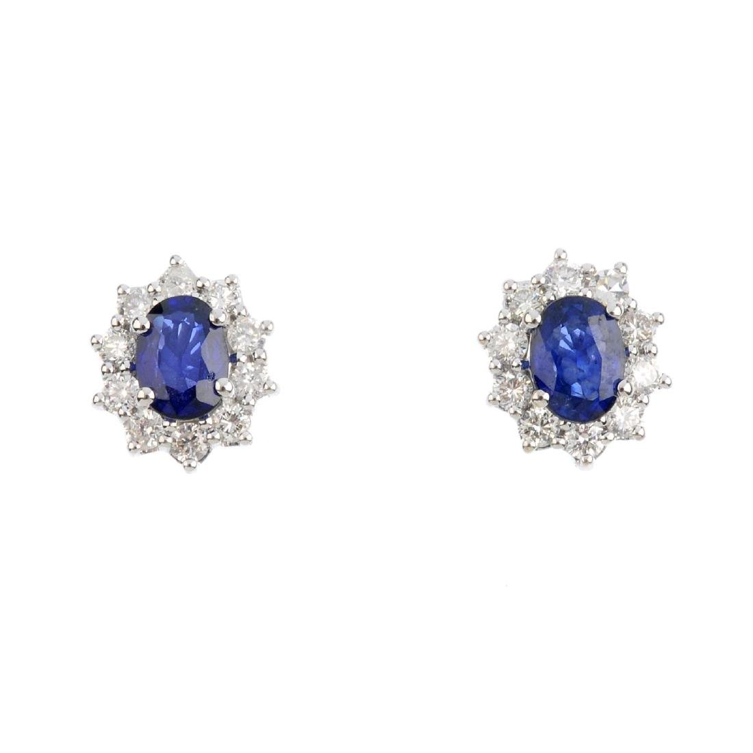 A pair of sapphire and diamond cluster earrings. The