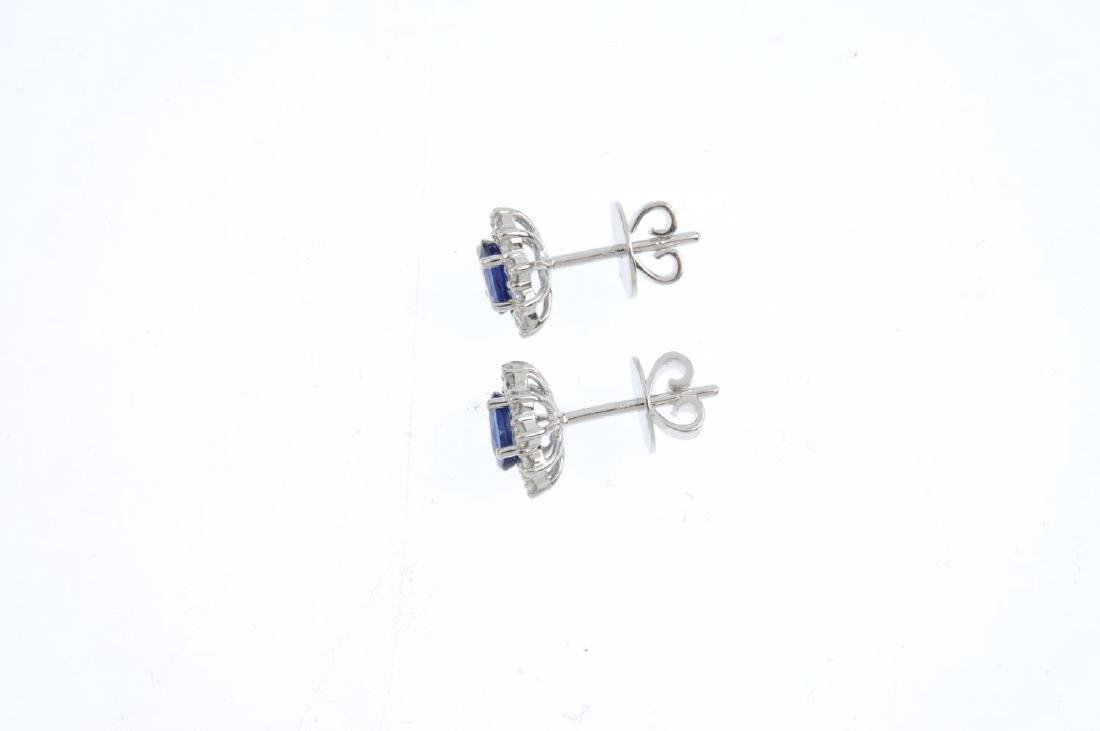 A pair of sapphire and diamond cluster earrings. The - 2