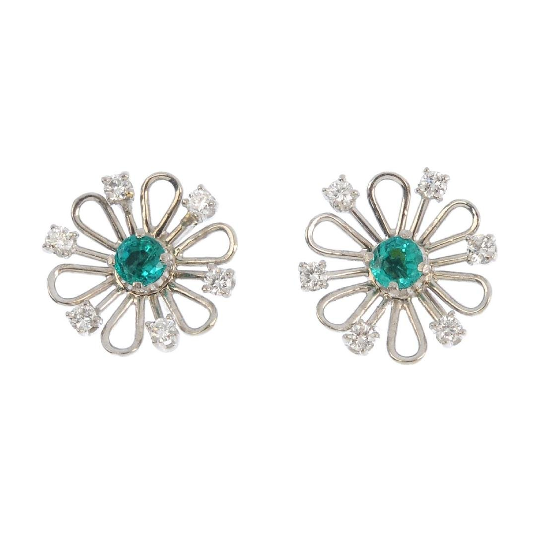 A pair of emerald and diamond floral earrings. The