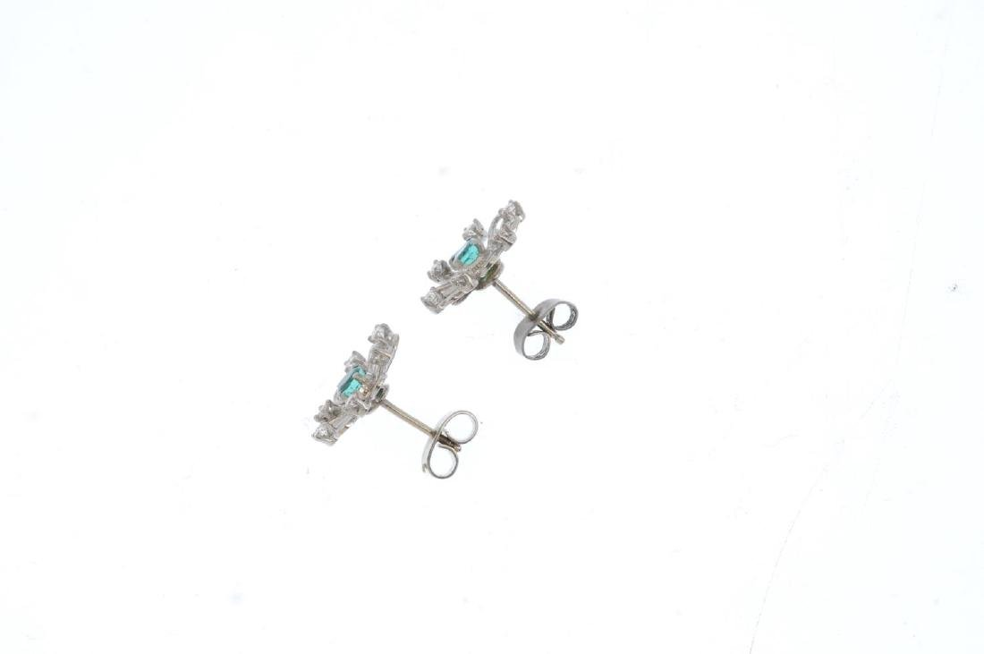 A pair of emerald and diamond floral earrings. The - 2