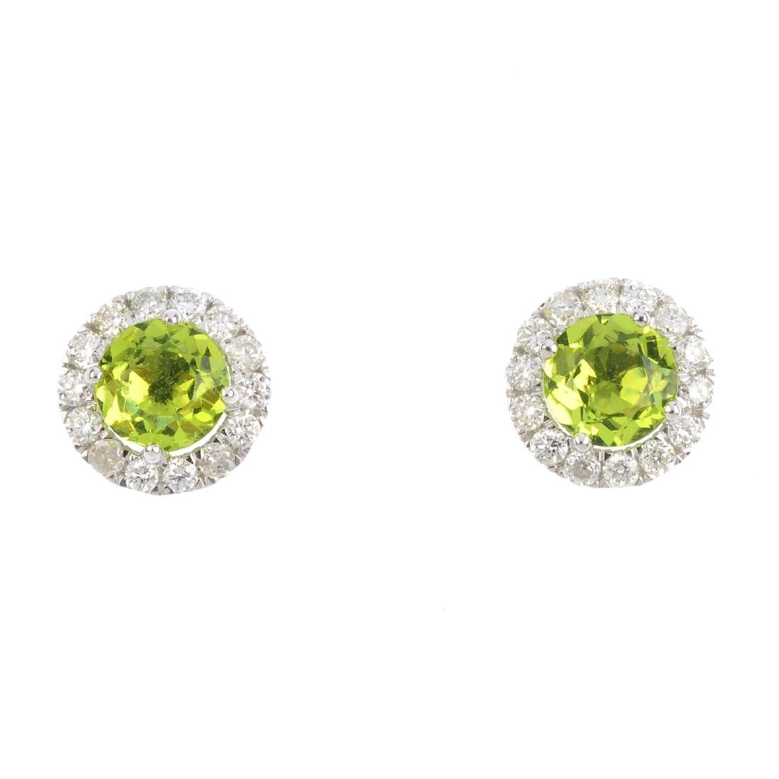 A pair of peridot and diamond cluster earrings. Each