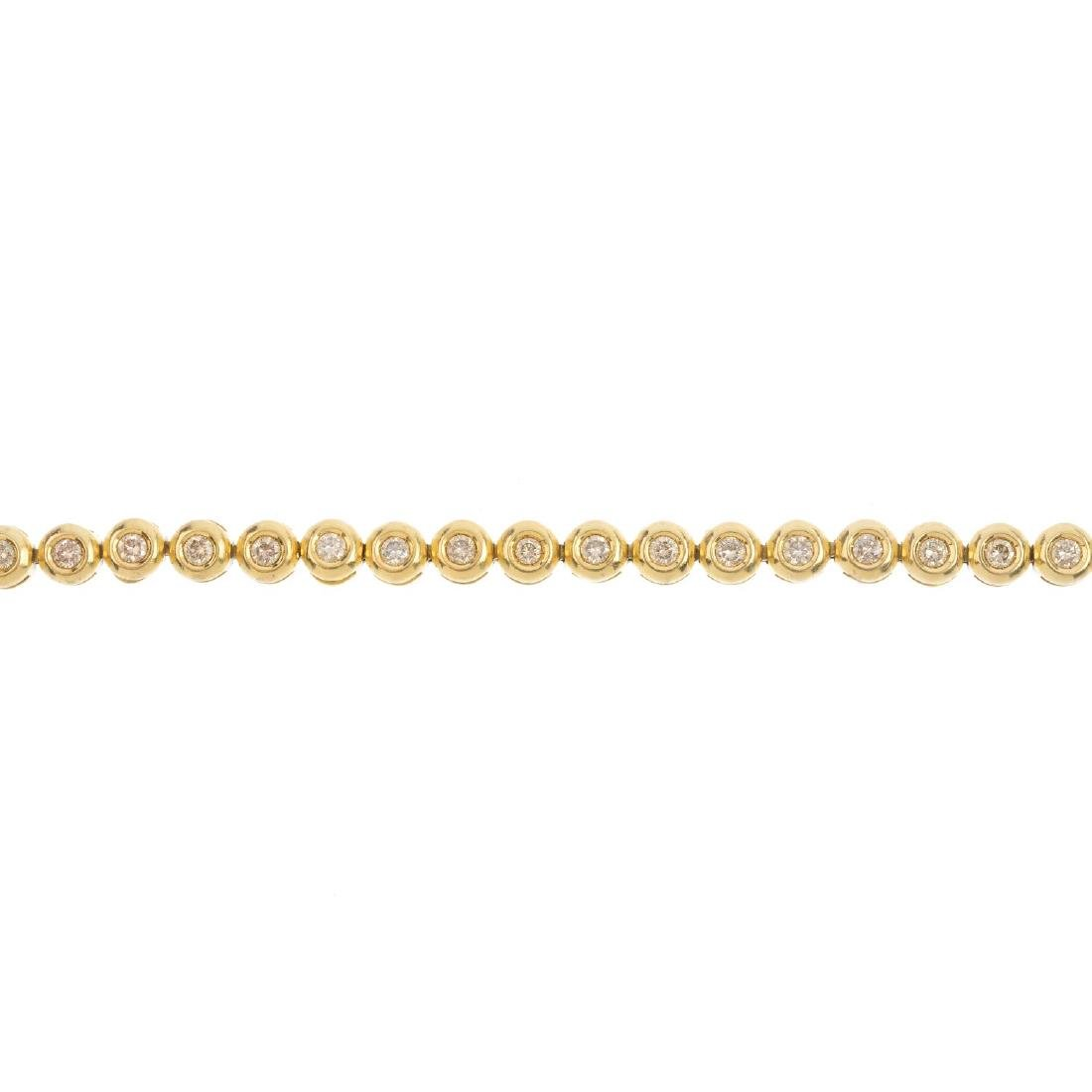 An 18ct gold diamond bracelet. Designed as a