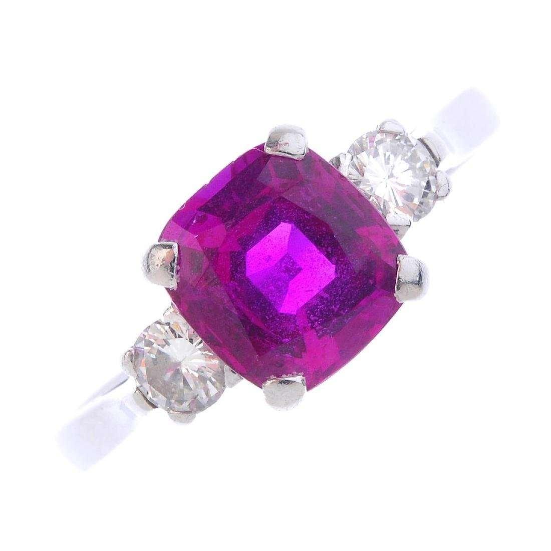 A Burmese ruby and diamond ring. The cushion-shape