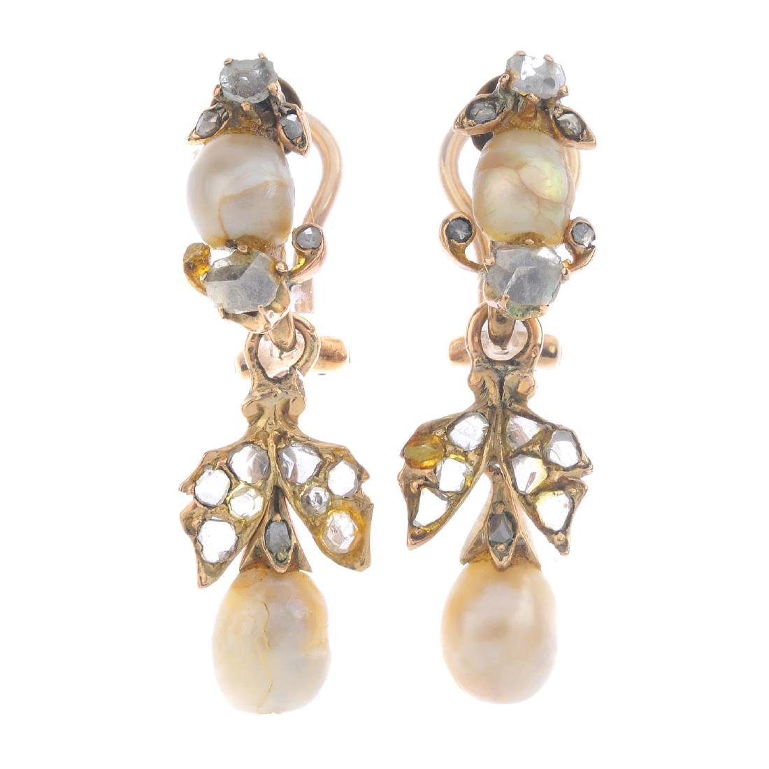 A pair of pearl and diamond earrings. Each designed as
