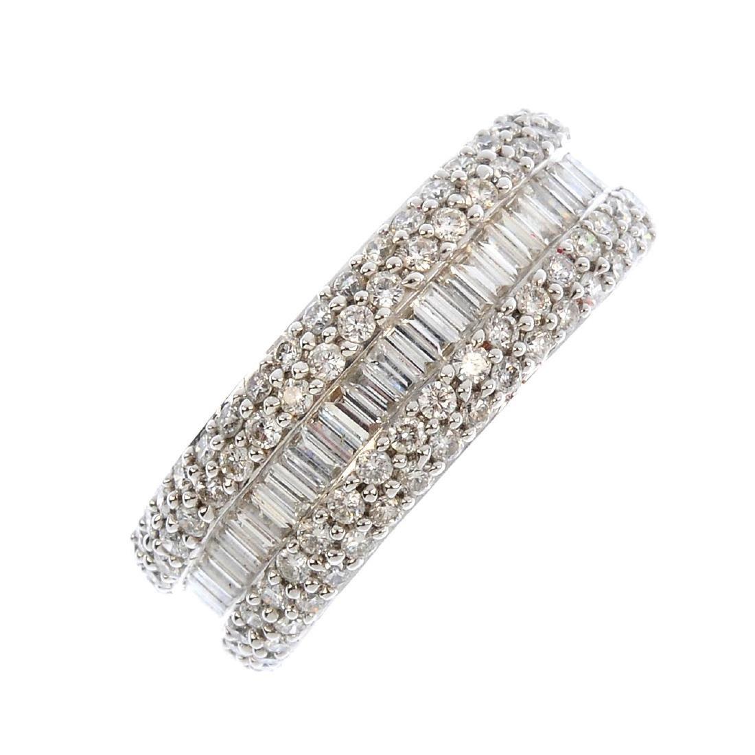 An 18ct gold diamond ring. The baguette-cut diamond