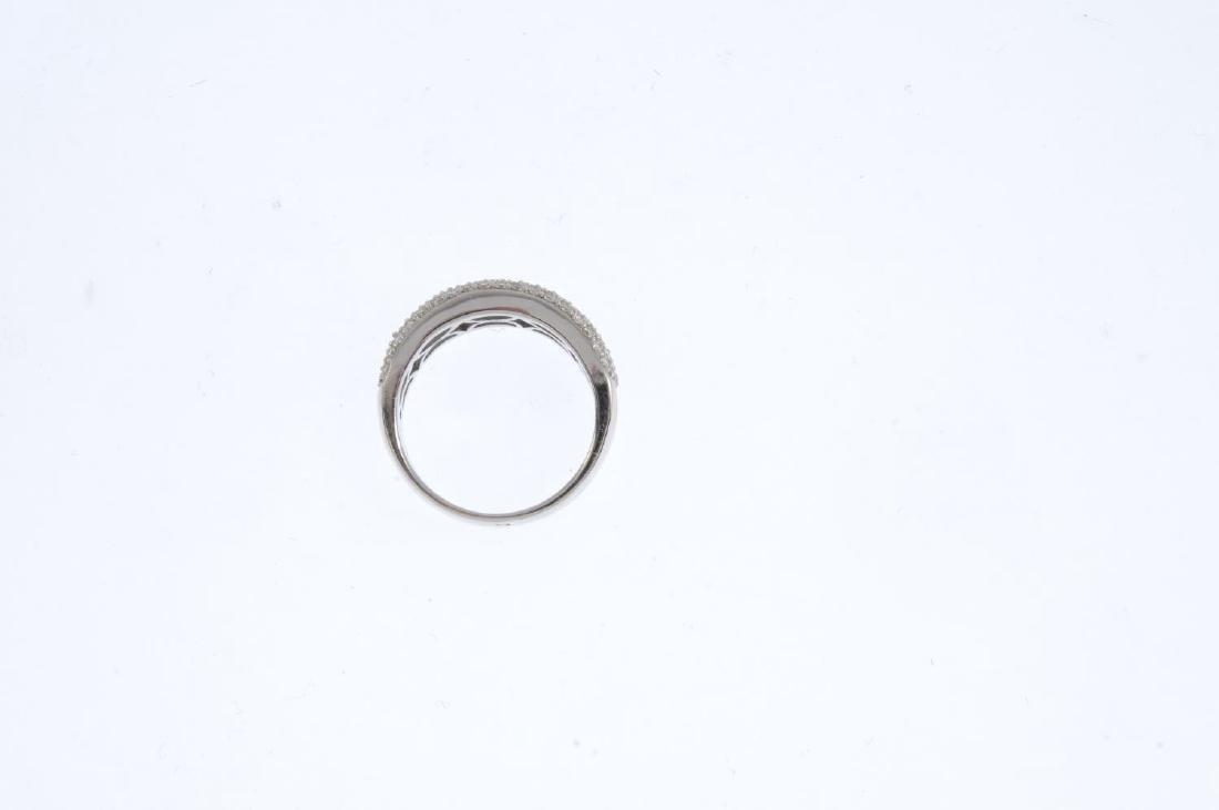 An 18ct gold diamond ring. The baguette-cut diamond - 2