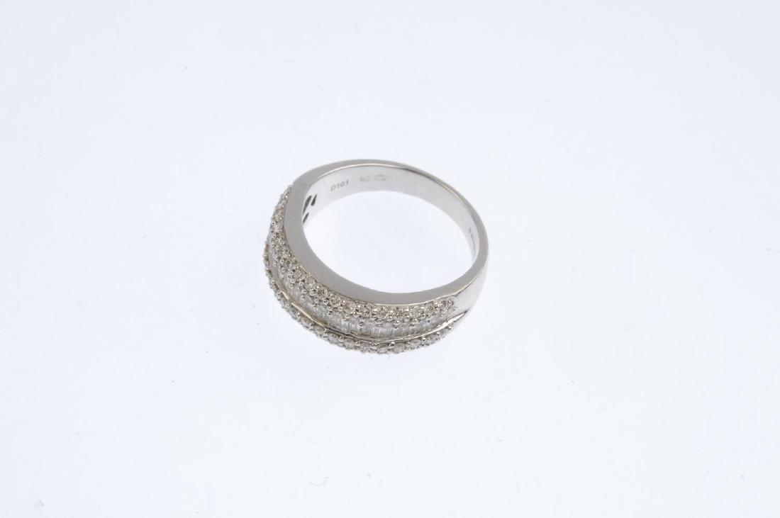 An 18ct gold diamond ring. The baguette-cut diamond - 3