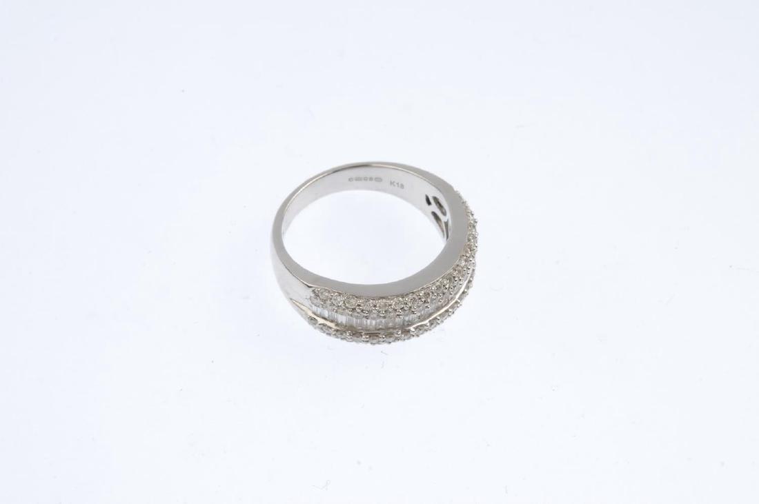 An 18ct gold diamond ring. The baguette-cut diamond - 4