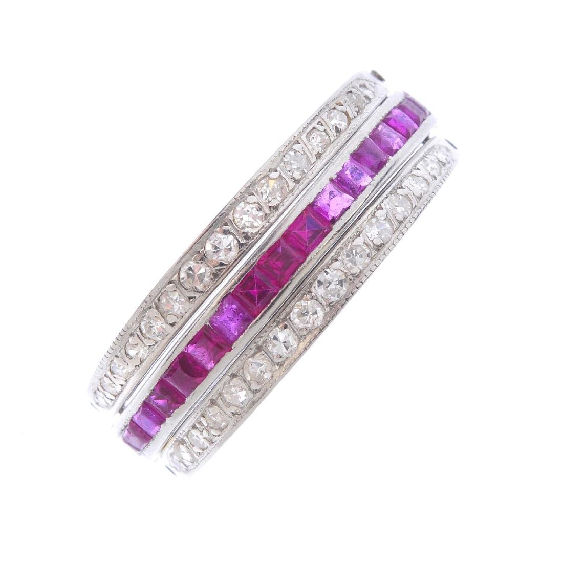 A ruby, sapphire and diamond swivel ring. The