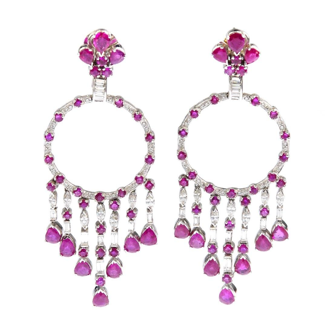 A pair of ruby and diamond earrings. Each designed as a