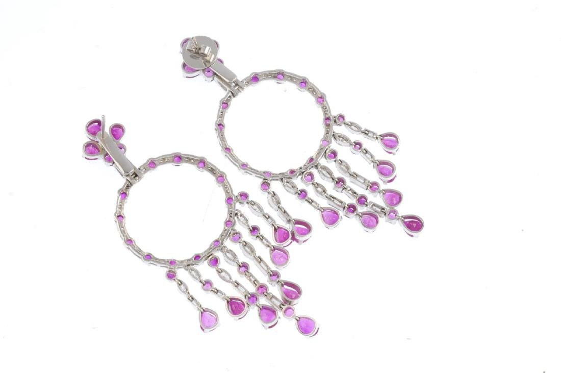 A pair of ruby and diamond earrings. Each designed as a - 2