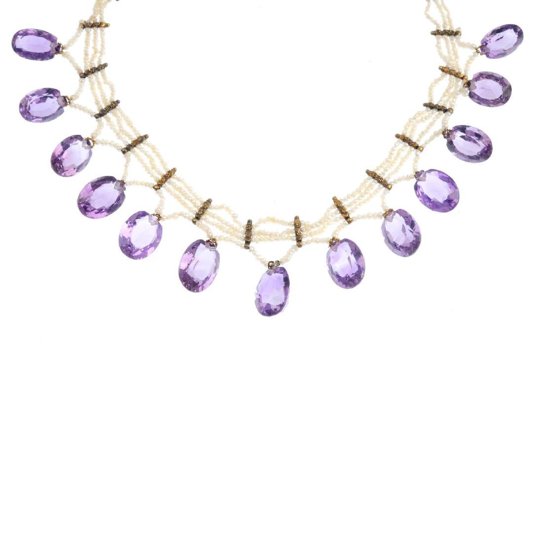 An amethyst and seed pearl necklace. Designed as three