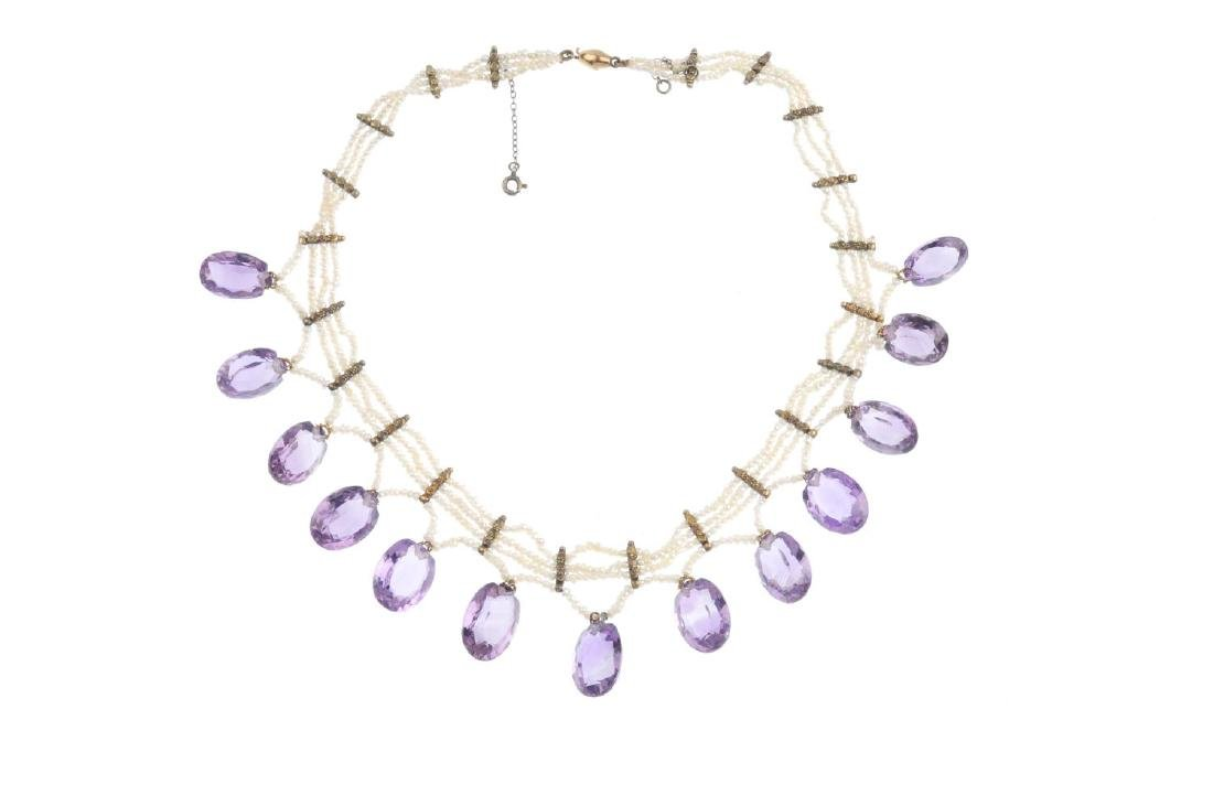 An amethyst and seed pearl necklace. Designed as three - 2