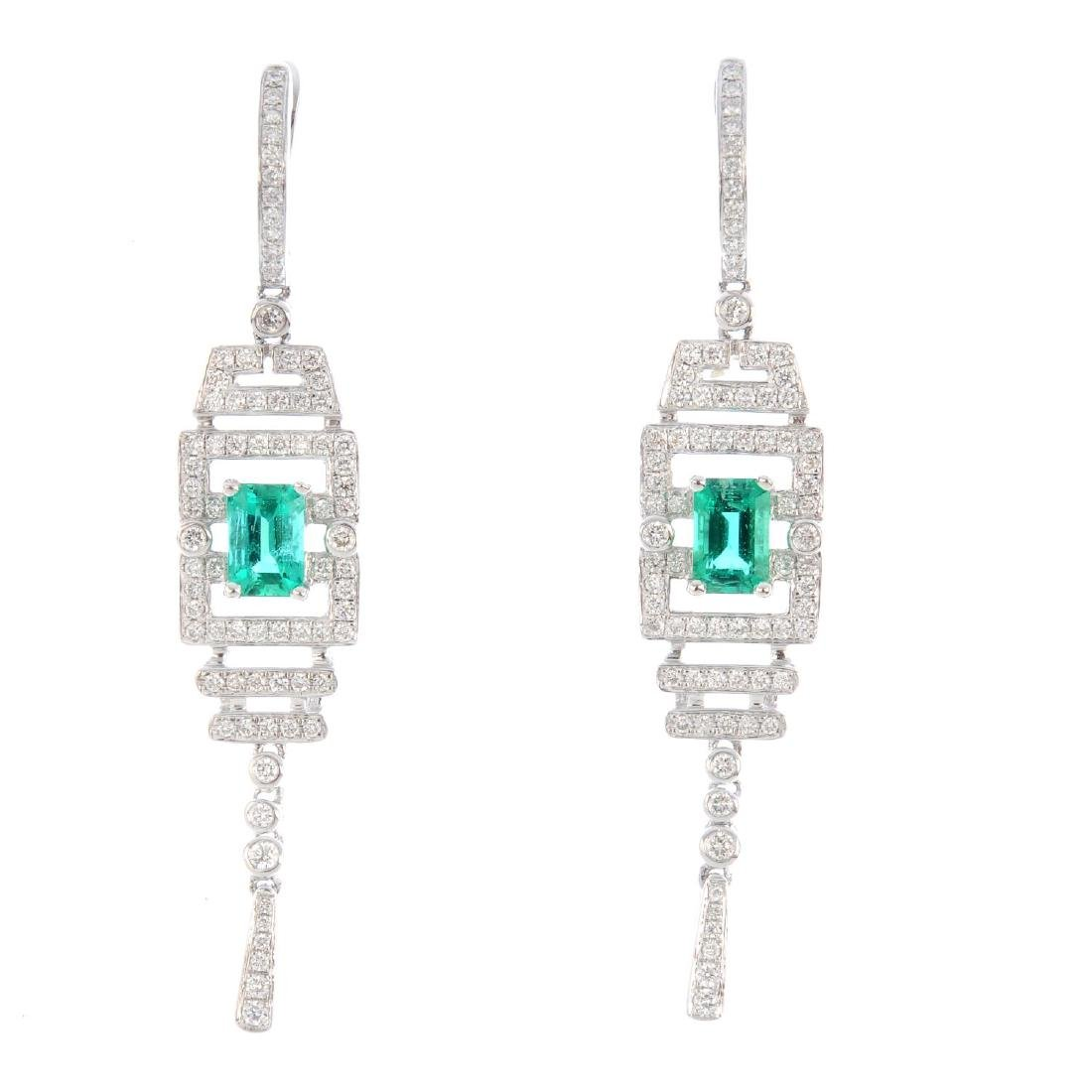 A pair of 18ct gold emerald and diamond earrings. Each