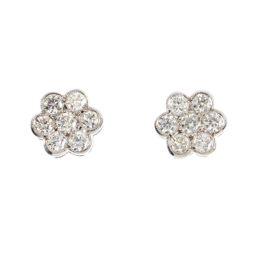 A pair of diamond cluster earrings. Each designed as a