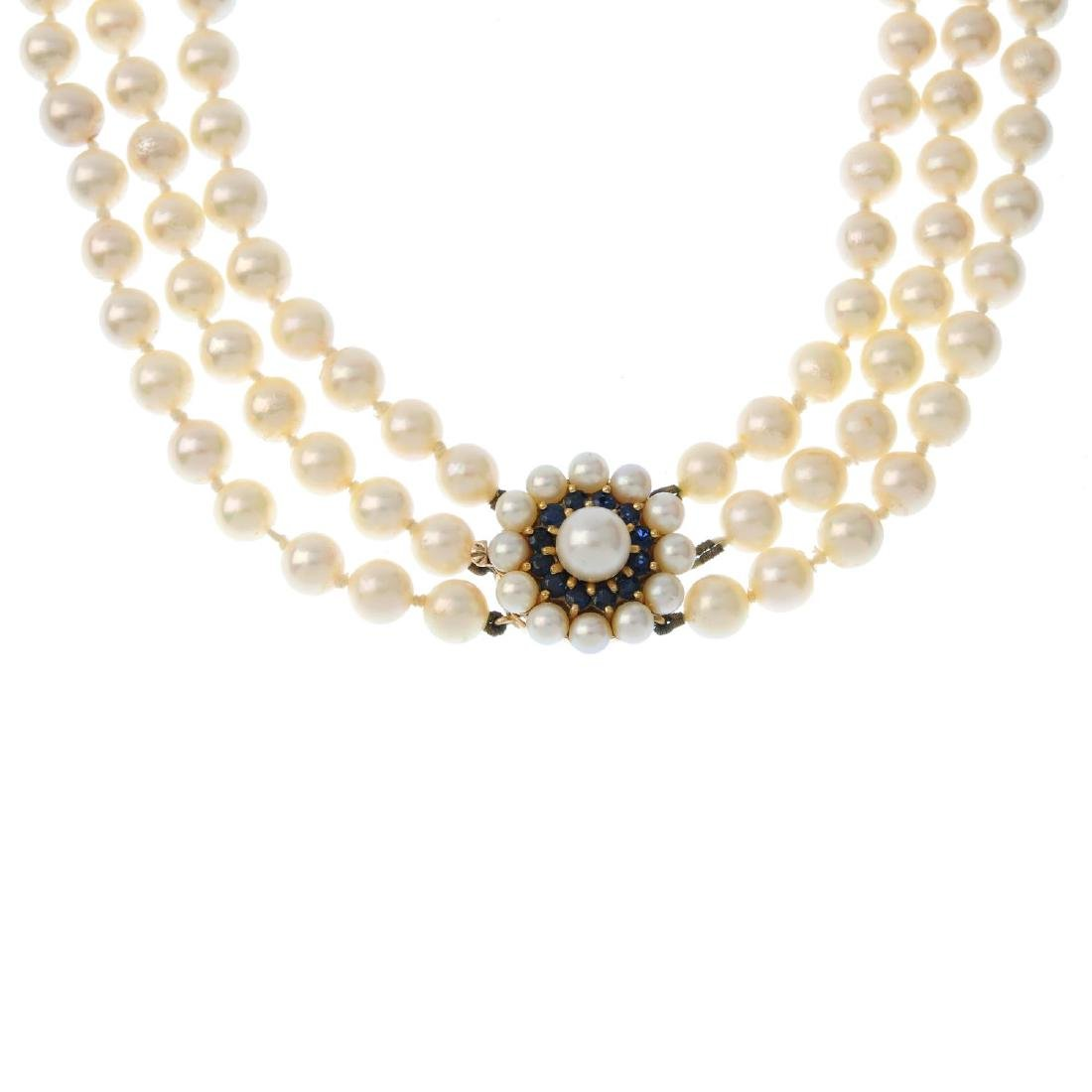 A cultured pearl three-row necklace. Comprising three