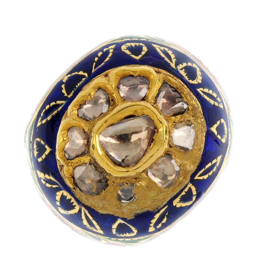 A diamond and enamel dress ring. The rose-cut diamond