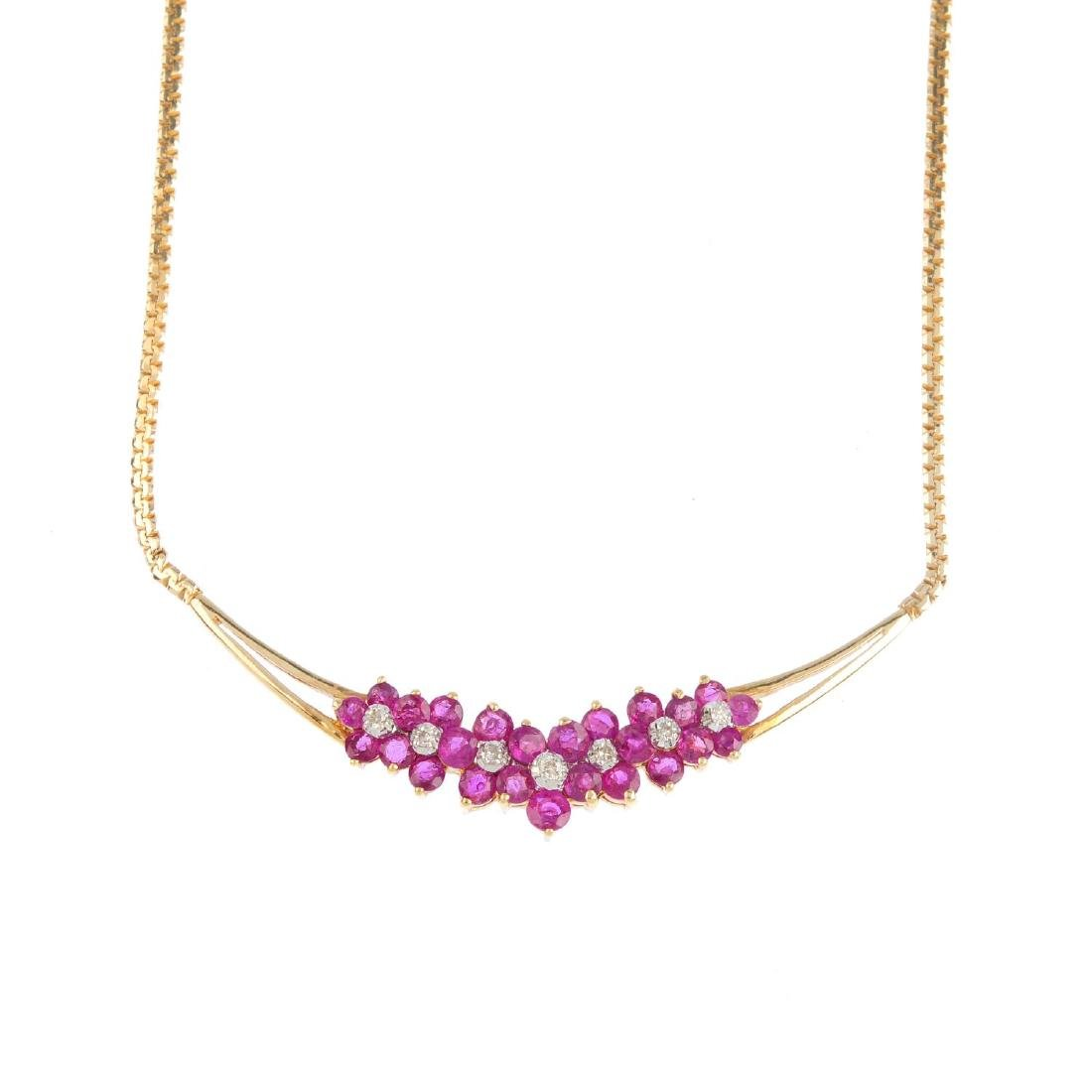 A ruby and diamond necklace. The brilliant-cut diamond