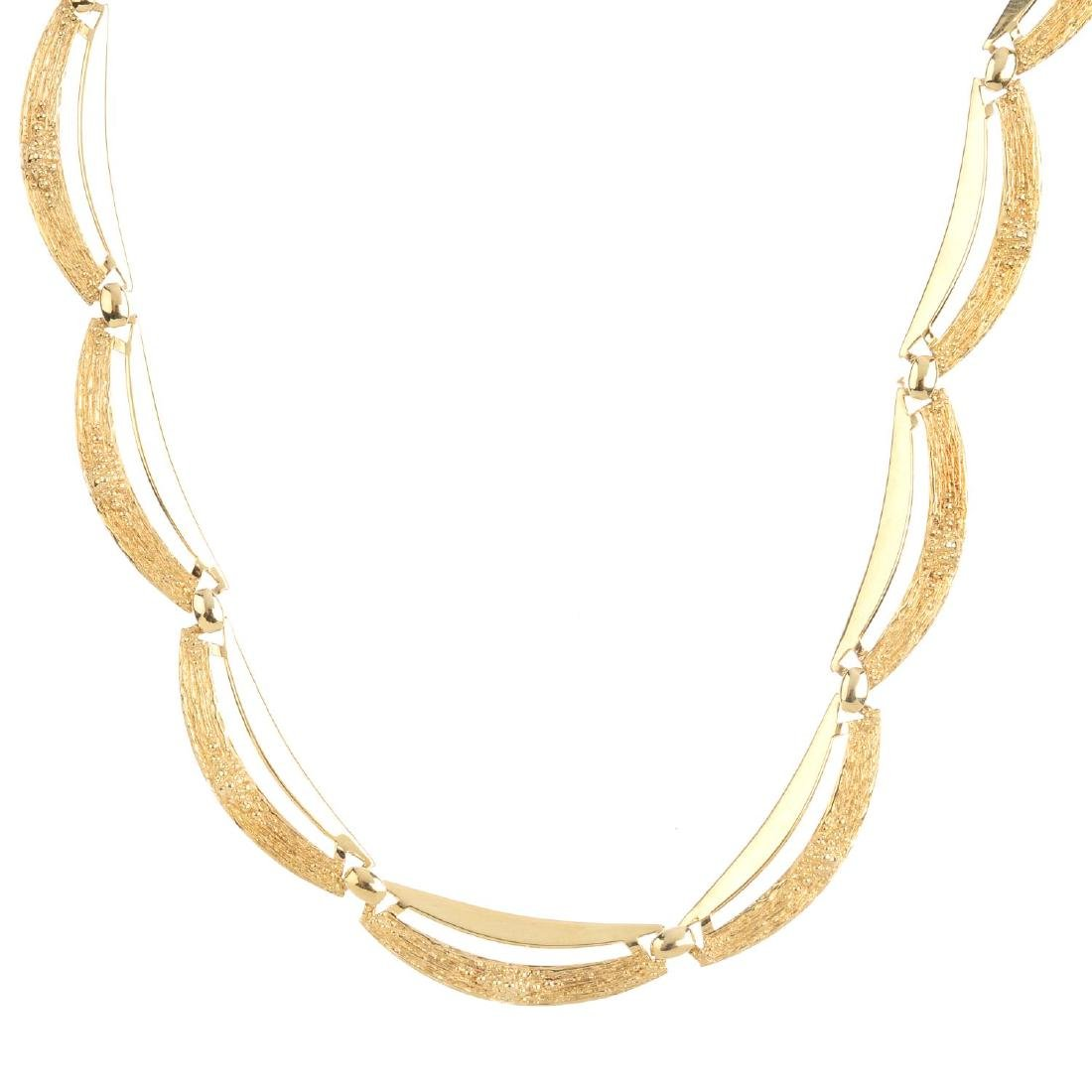 A 1970s 9ct gold necklace. Comprising a series of