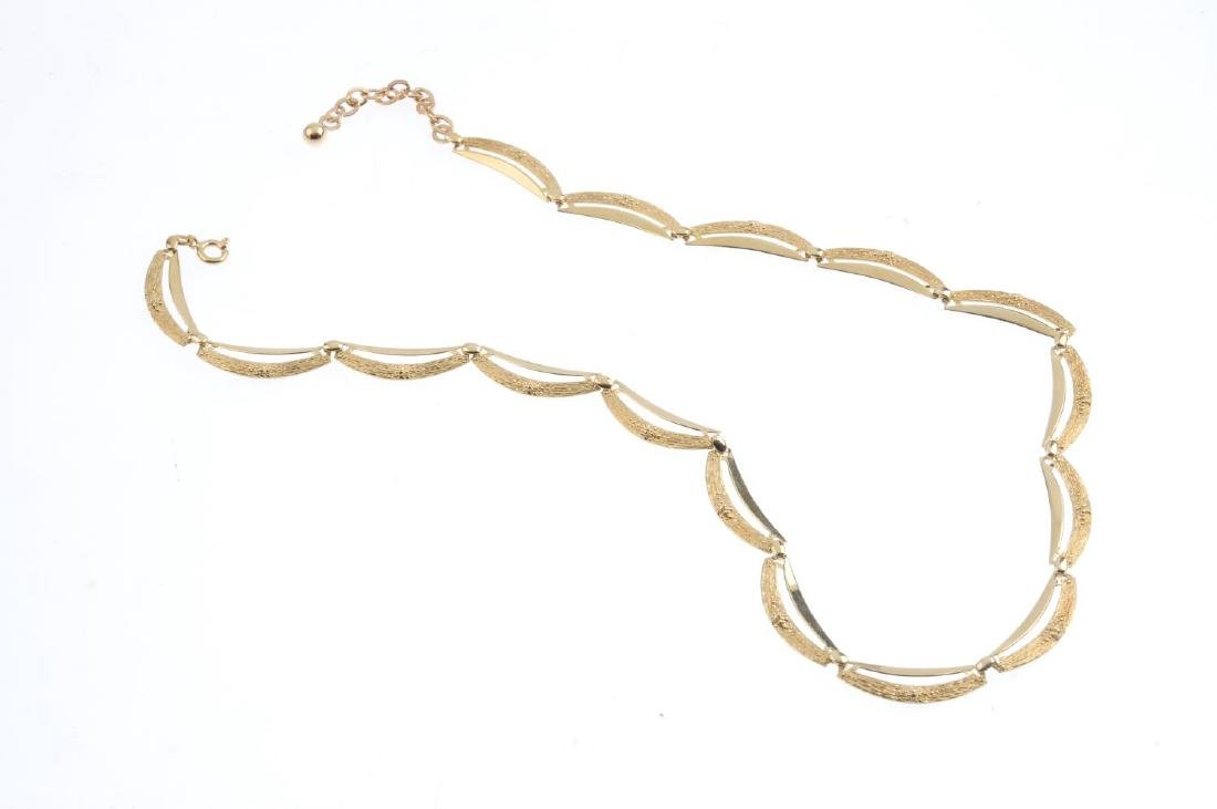 A 1970s 9ct gold necklace. Comprising a series of - 2