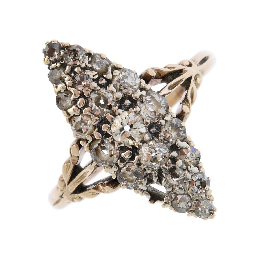 A diamond cluster ring. Of marquise-outline, the