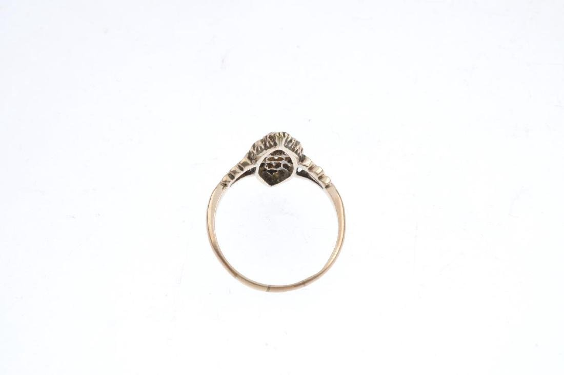 A diamond cluster ring. Of marquise-outline, the - 3