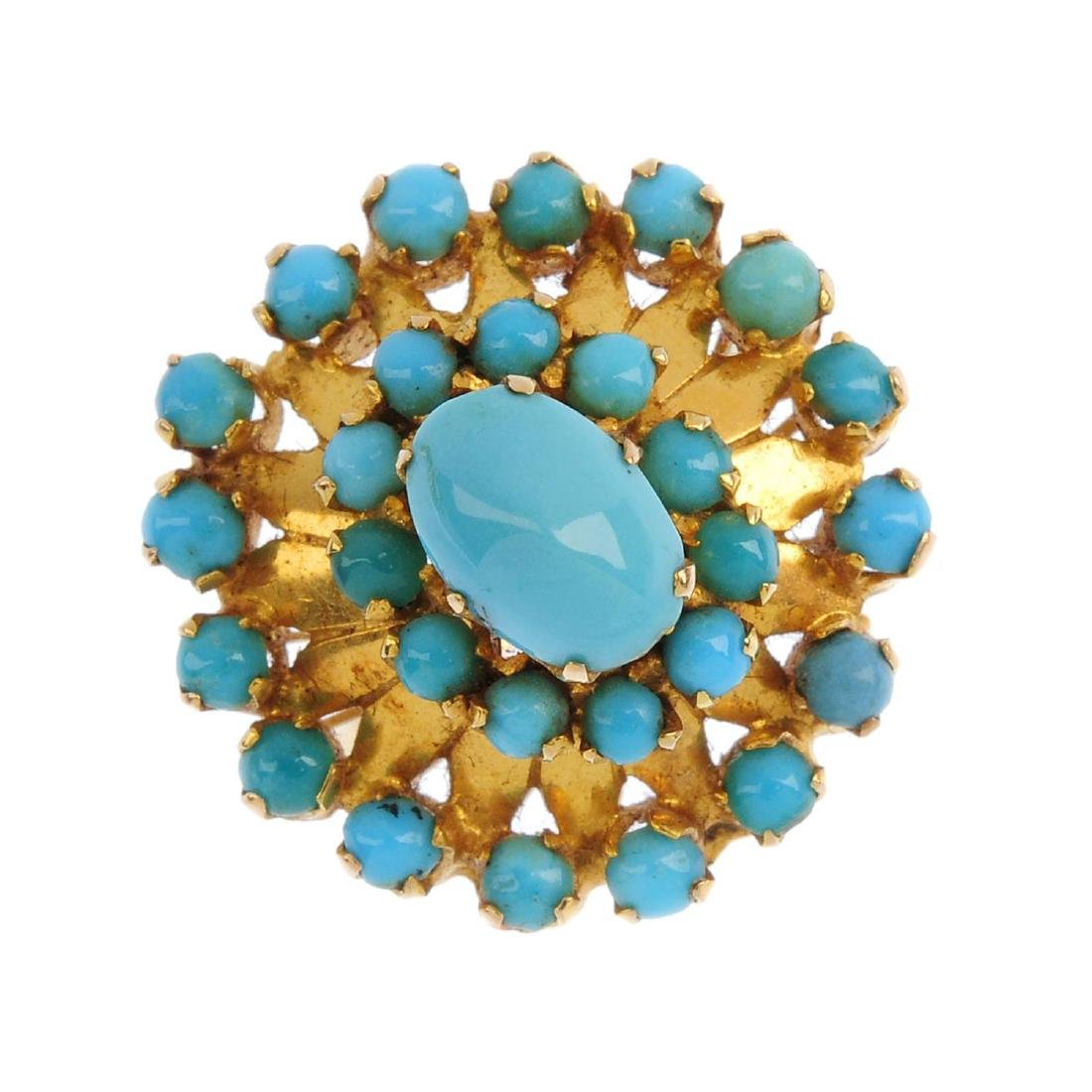 A turquoise floral ring. The oval and circular