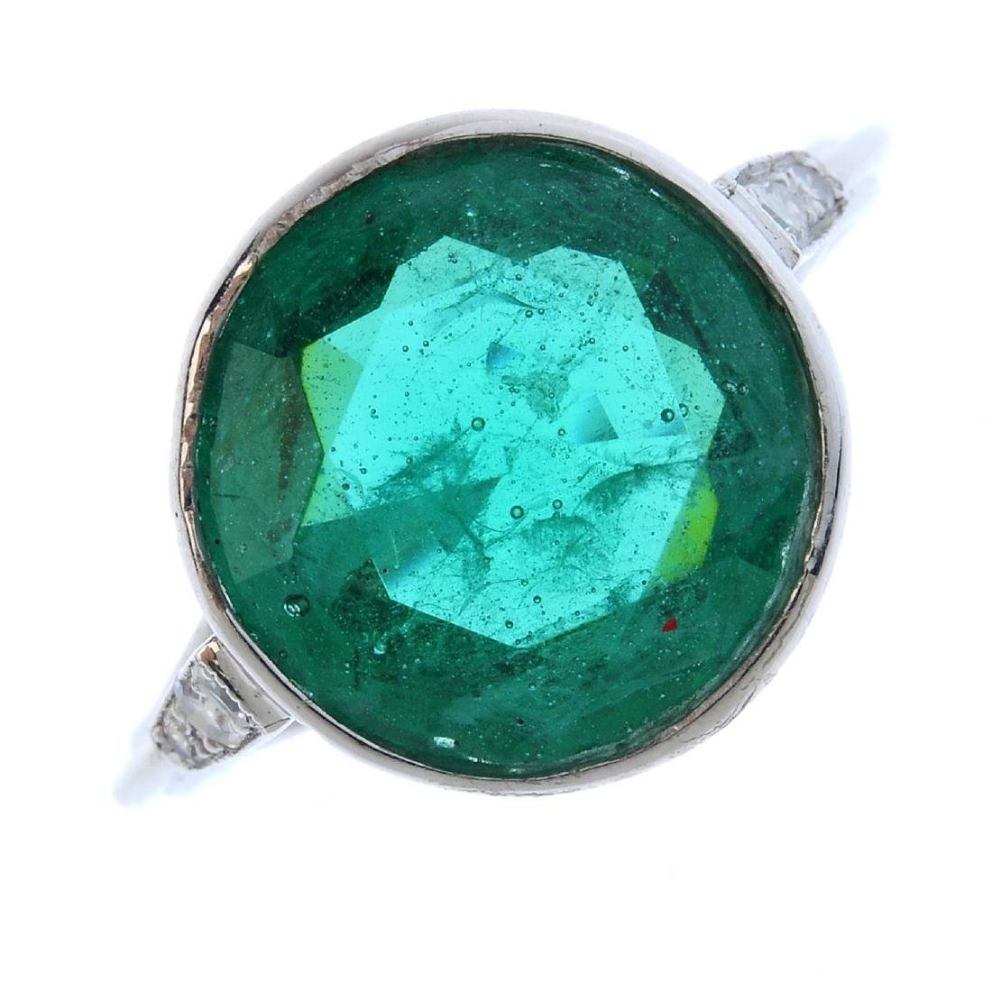 A paste and diamond ring. The circular-shape green