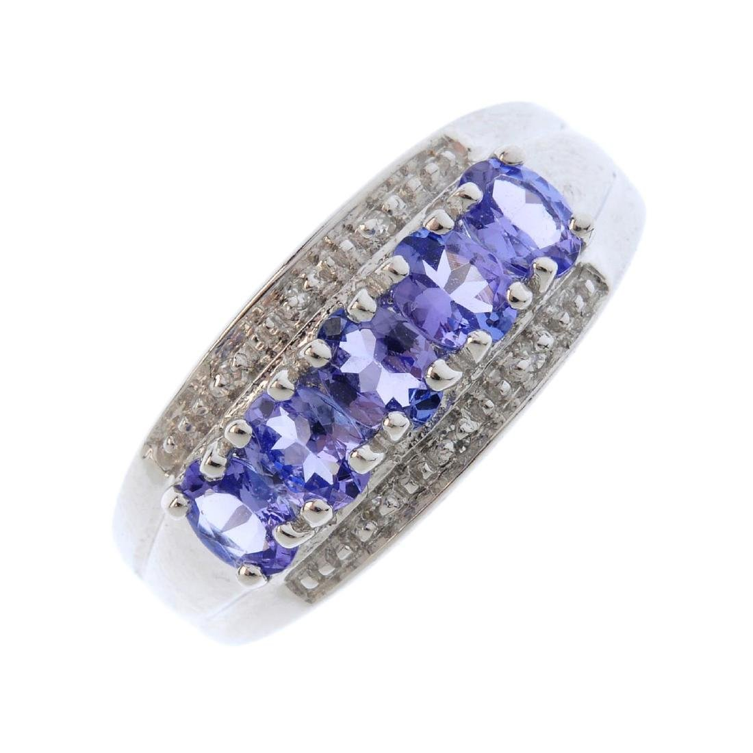A 9ct gold tanzanite and diamond dress ring. The