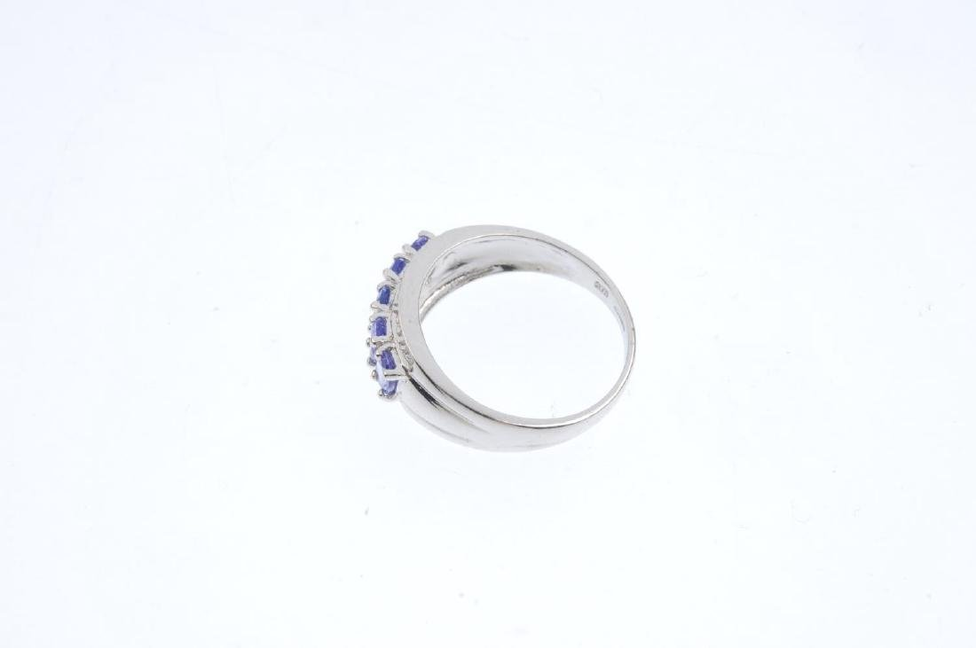 A 9ct gold tanzanite and diamond dress ring. The - 2