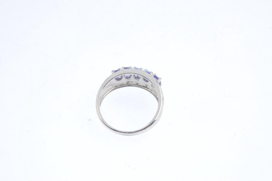 A 9ct gold tanzanite and diamond dress ring. The - 3
