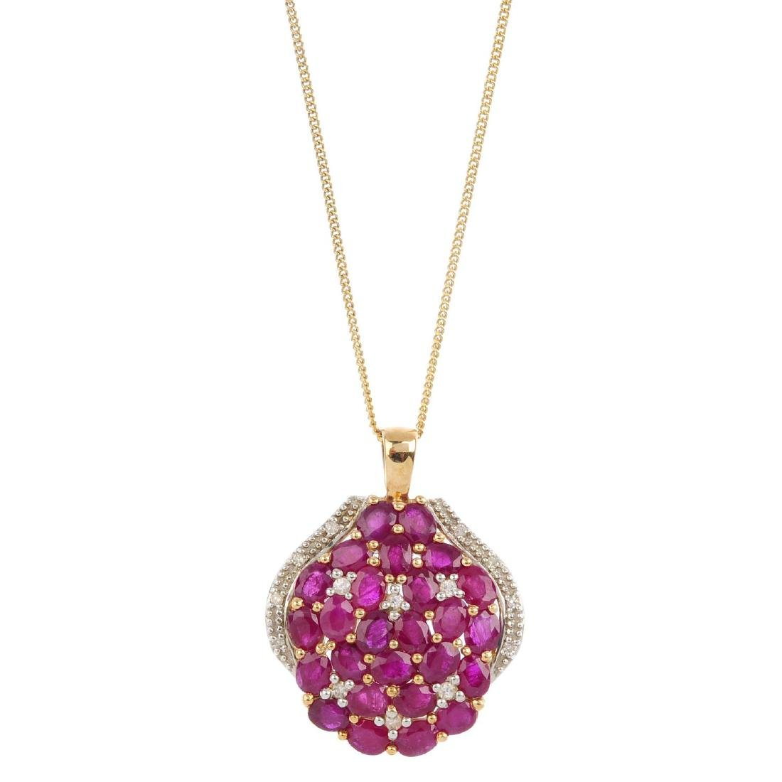 A ruby, cubic zirconia and diamond pendant. Designed as