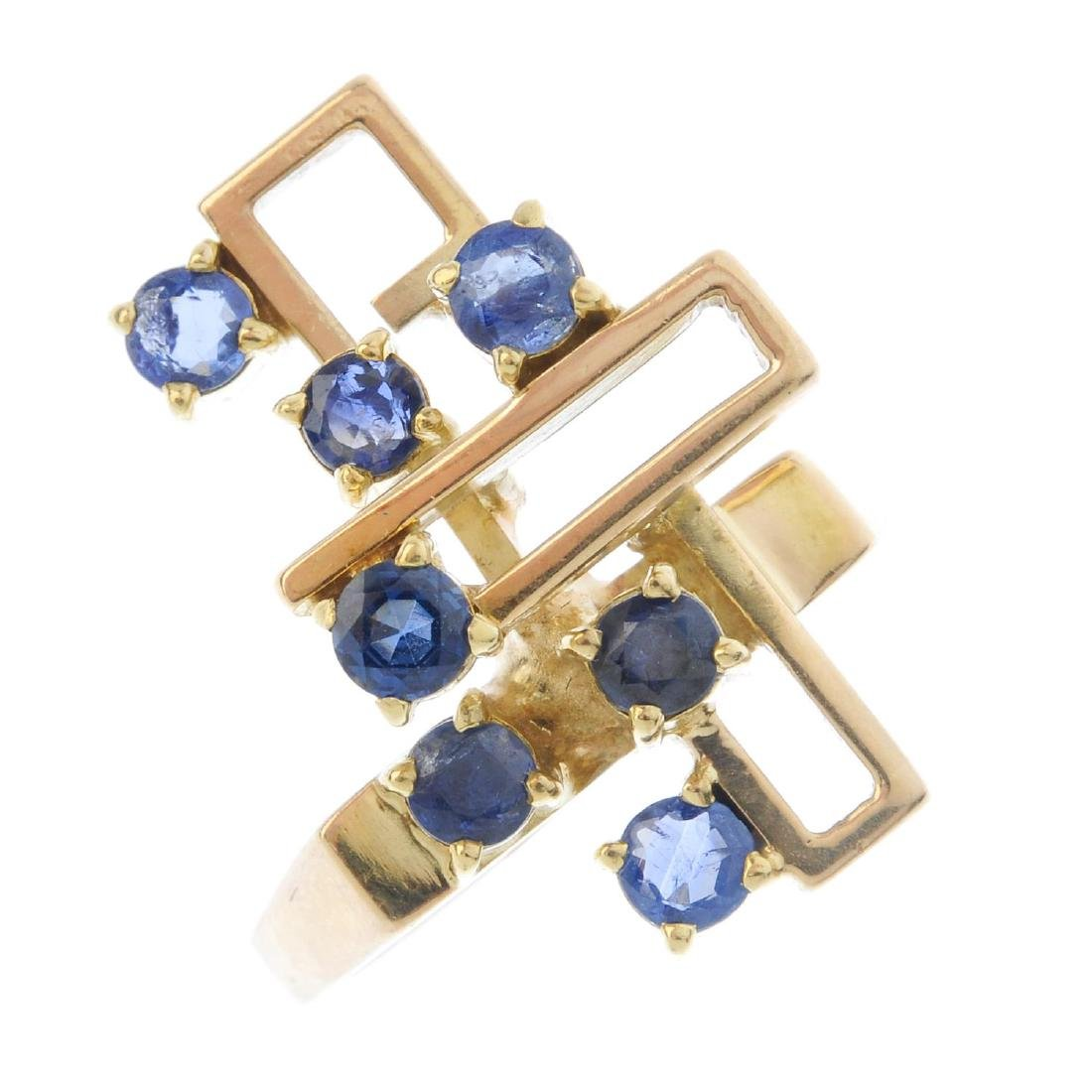 A sapphire dress ring. Of geometric design, with the