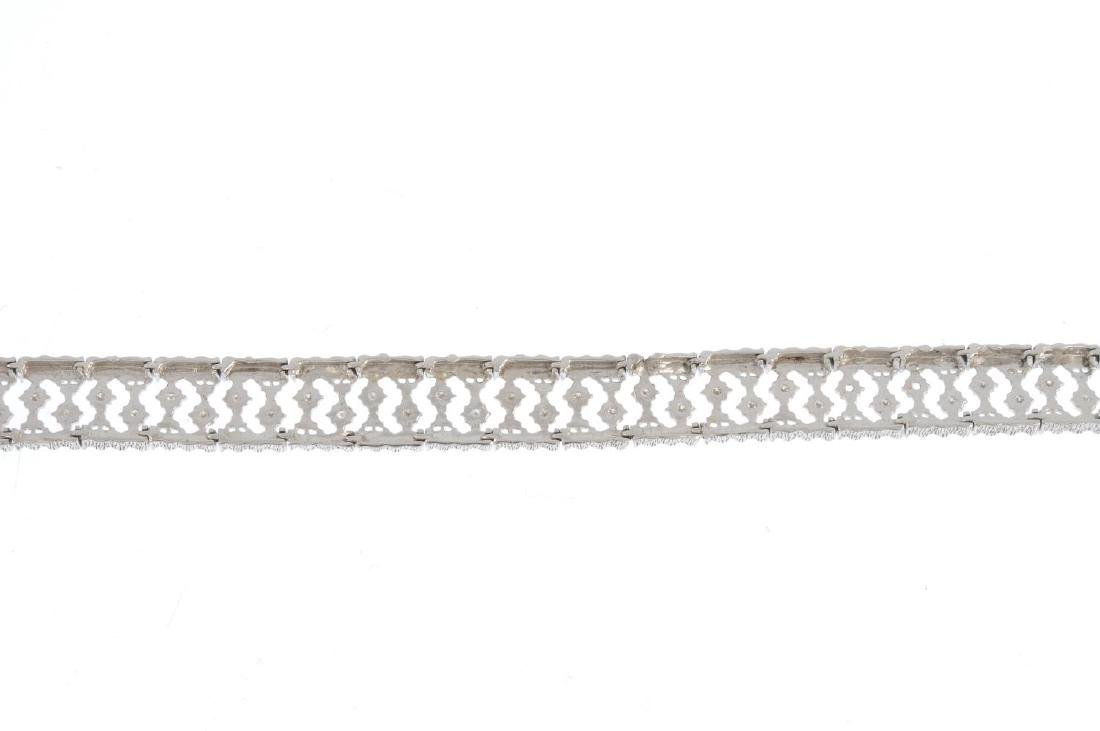 A 9ct gold diamond bracelet. Of openwork design, the - 2