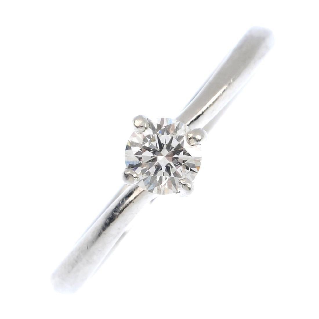 A platinum diamond single-stone ring. The brilliant-cut
