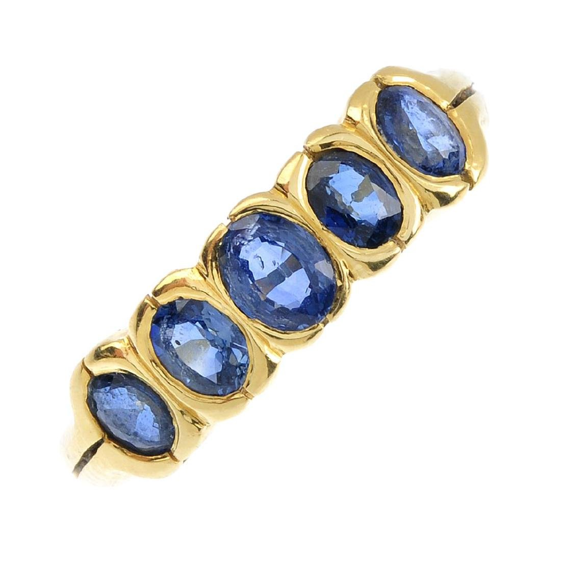 An 18ct gold sapphire five-stone ring. The oval-shape