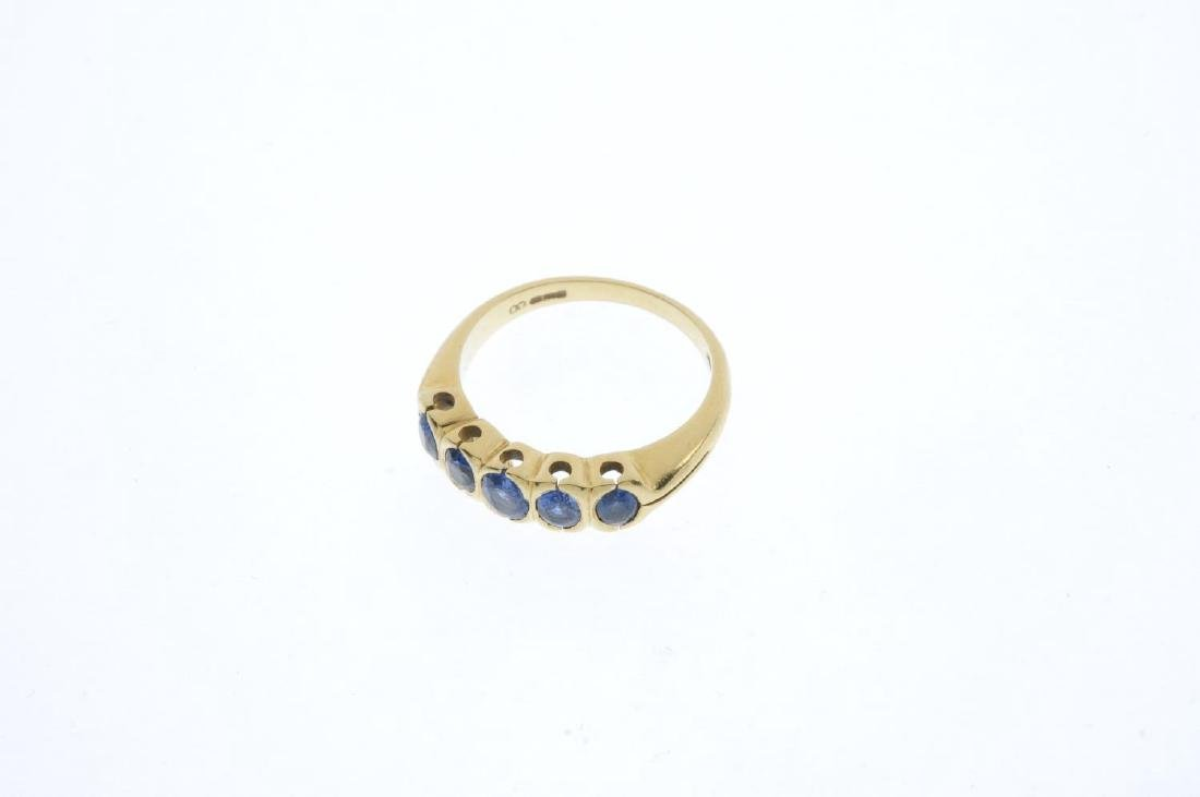 An 18ct gold sapphire five-stone ring. The oval-shape - 2