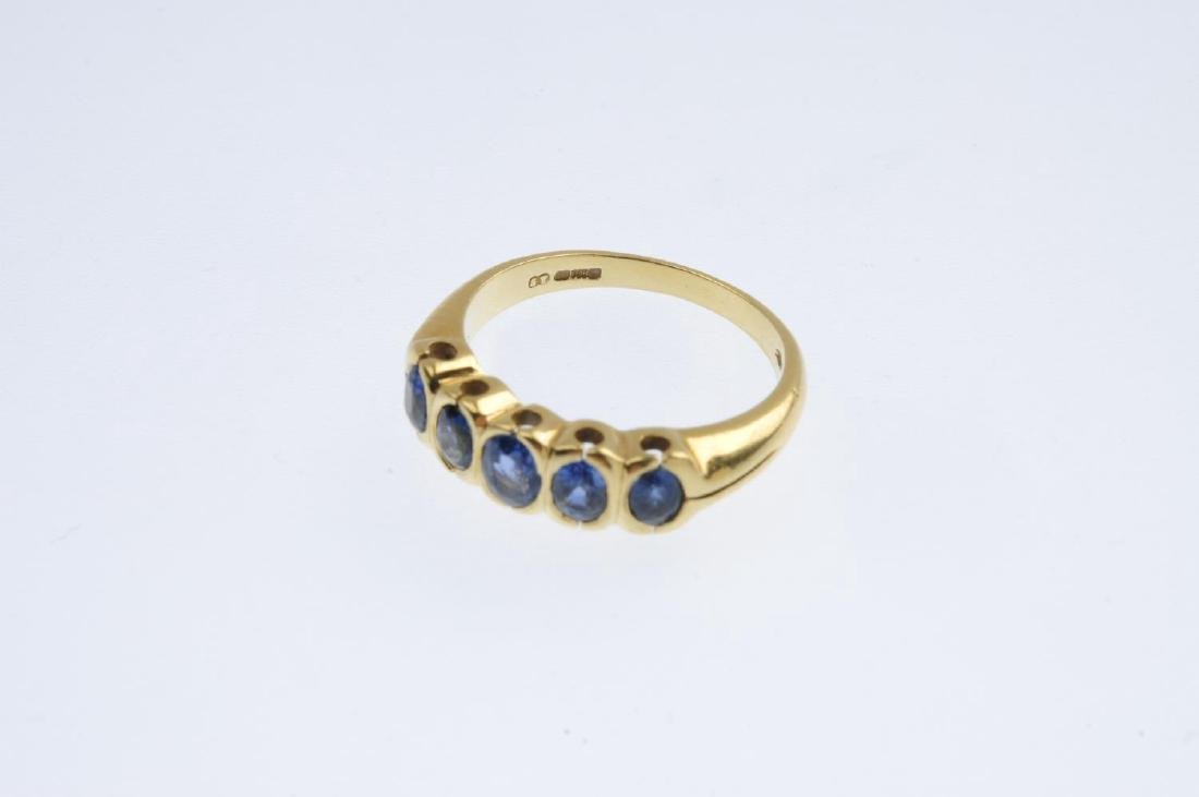 An 18ct gold sapphire five-stone ring. The oval-shape - 3