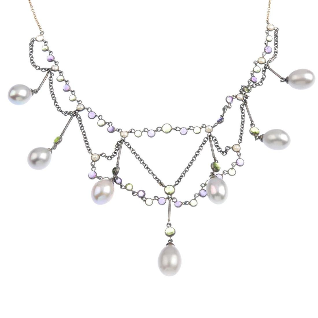 A cultured pearl and gem-set necklace. Designed as an