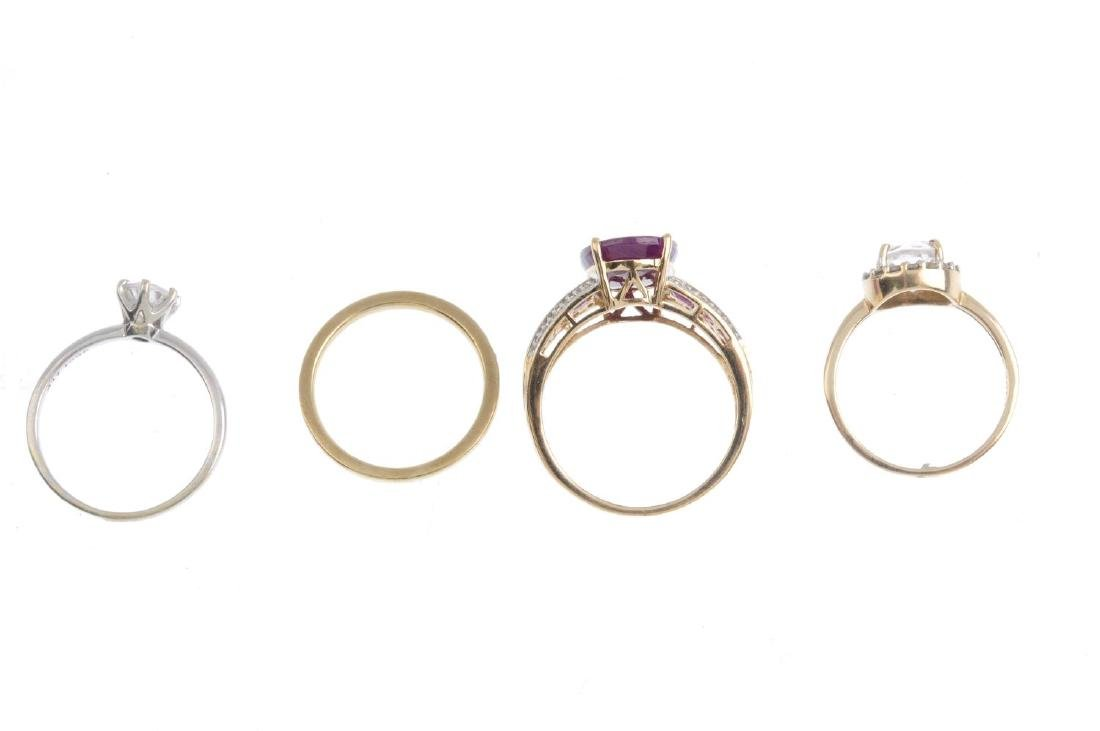 Four gem-set rings. To include a 9ct gold synthetic - 2