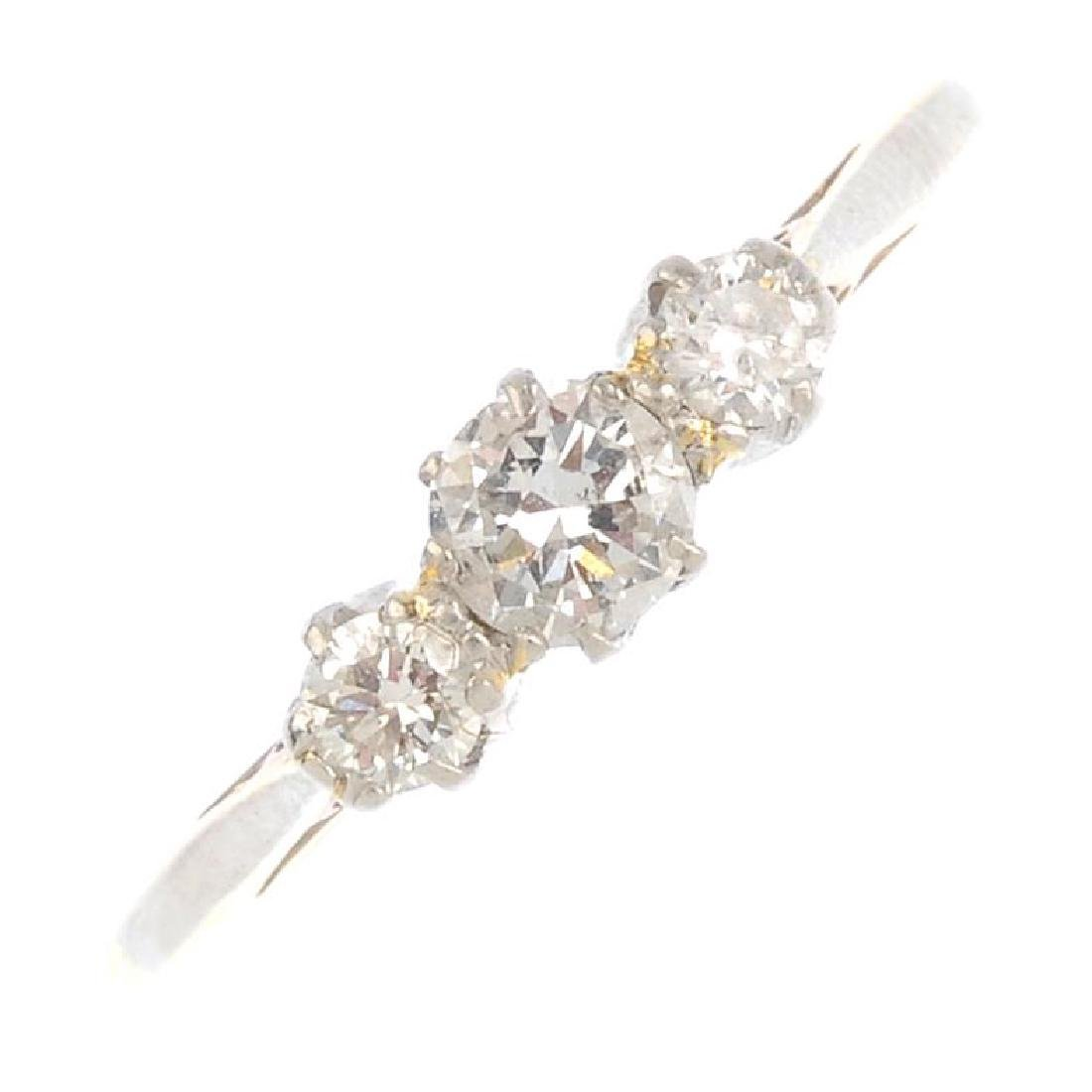An 18ct gold and platinum diamond three-stone ring. The