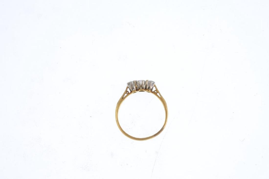 An 18ct gold and platinum diamond three-stone ring. The - 2