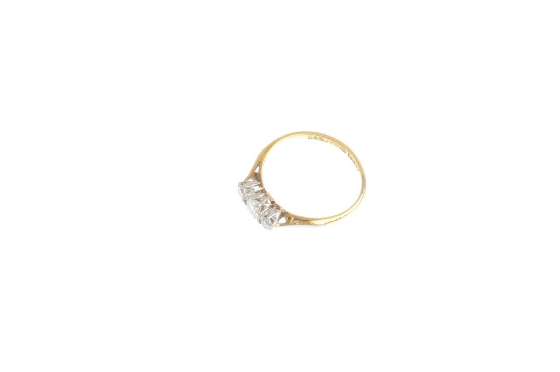 An 18ct gold and platinum diamond three-stone ring. The - 3