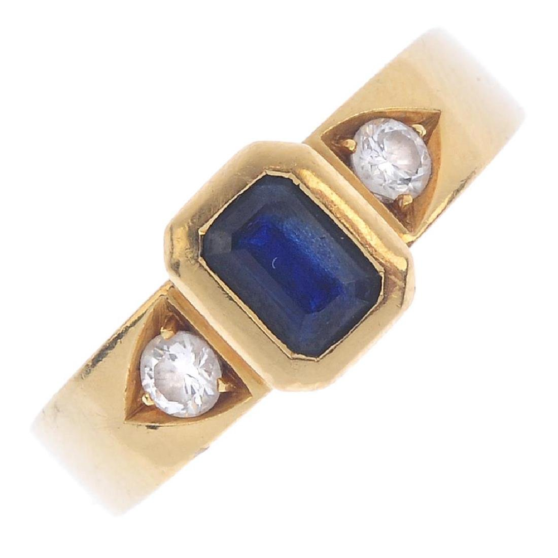 A sapphire and diamond ring. Designed as a
