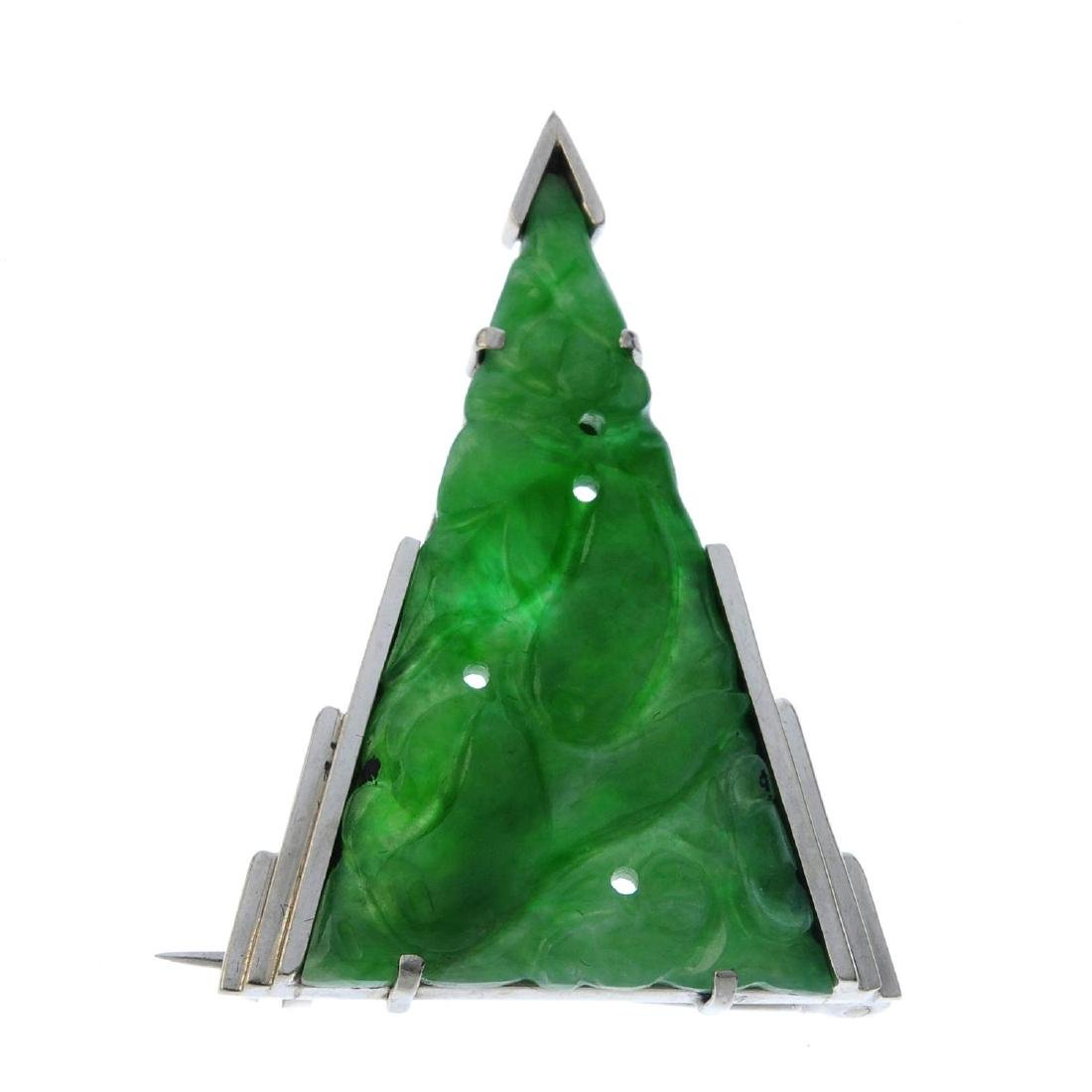 A jade brooch. The triangular jadeite panel, carved to